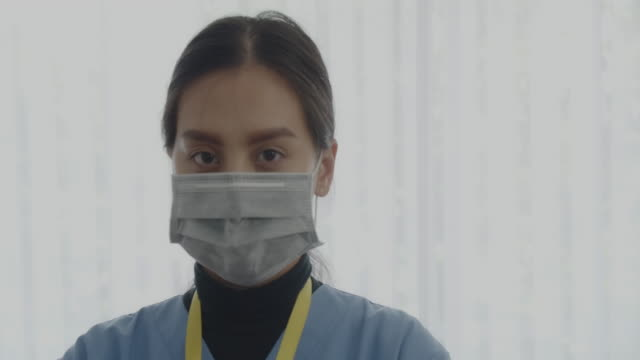 nurse portrait wearing a medical mask. - 70 79 years stock videos & royalty-free footage