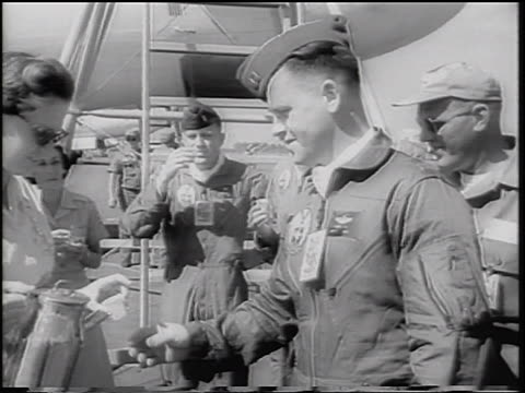 b/w 1960 nurse pouring oral polio vaccine into paper cups us air force pilots drinking it - 1960 stock videos & royalty-free footage