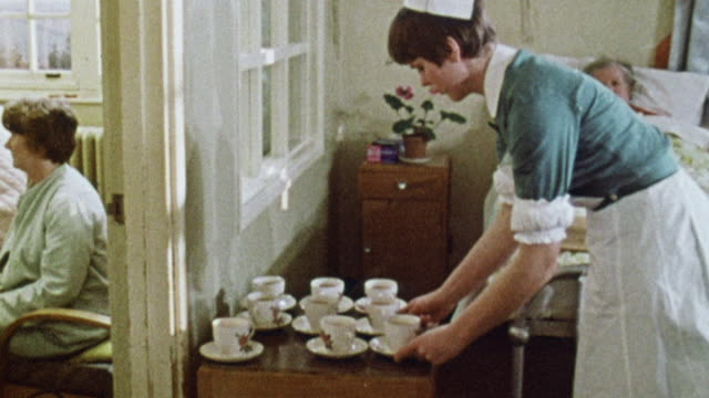 montage nurse pouring tea and serving food to psychiatric patients / plymouth, england, united kingdom - anno 1969 video stock e b–roll