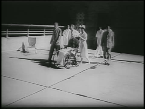 nurse pushing dwight eisenhower in wheelchair outdoors / after heart attack - 1955 stock videos & royalty-free footage
