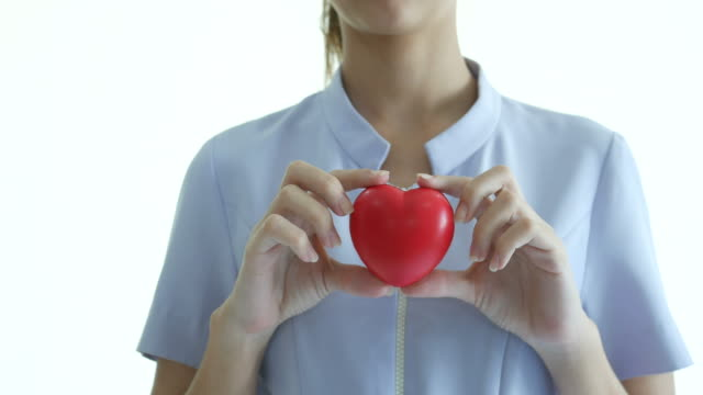 nurse showing red heart ball - protection stock videos & royalty-free footage
