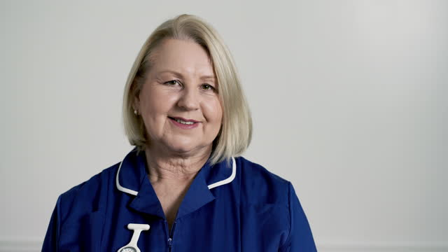 nurse smiling to camera - healthcare worker stock videos & royalty-free footage