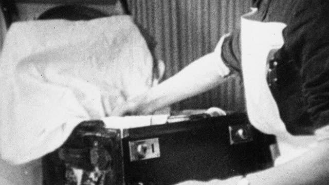 1944 MONTAGE Nurse sterilizing and packing medical instruments for mobile childbirth doctors / Scotland, United Kingdom