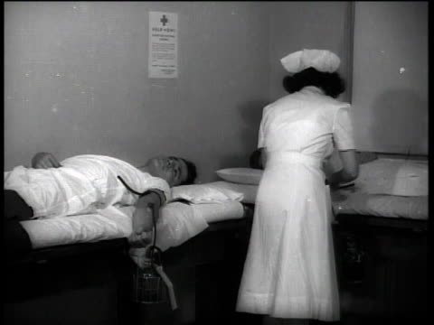 1941 nurse taking blood from donors / boston, massachusetts, united states - collection stock videos & royalty-free footage