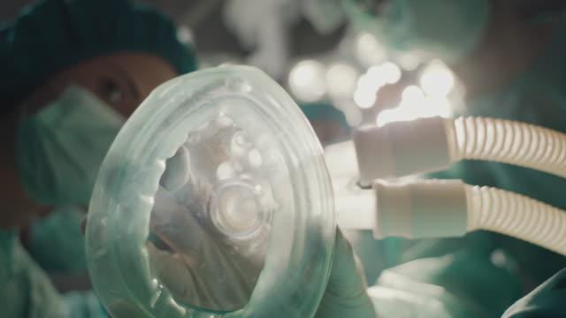 nurse taking of oxygen mask - oxygen mask stock videos & royalty-free footage