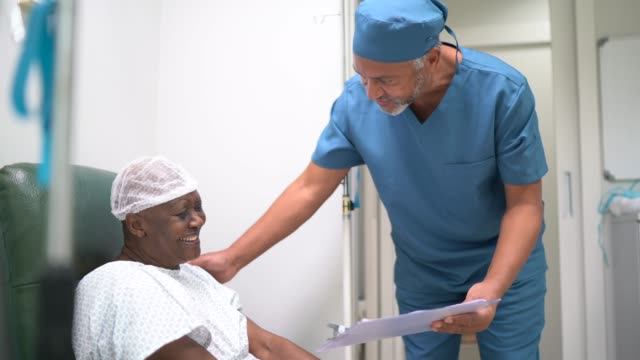 nurse talking and doing a emotional support to a female senior patient at hospital - emotional support stock videos & royalty-free footage