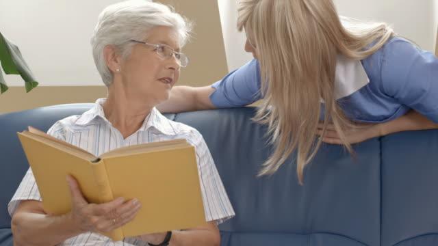 HD DOLLY: Nurse Talking With Elderly Woman