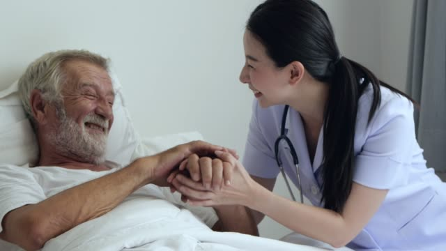 nurse visit old man - hospital stock videos & royalty-free footage