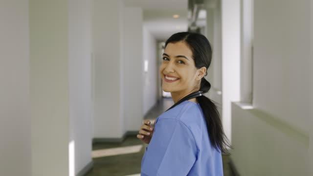 nurse walking down hallway of a hospital. - nurse walking stock videos & royalty-free footage