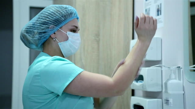 a nurse washes her hands. - female nurse stock videos & royalty-free footage