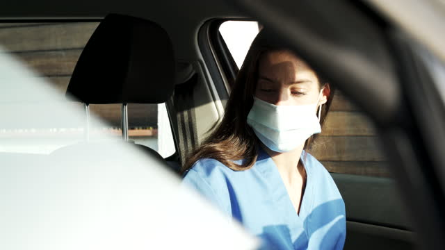a nurse worker commuting home inside a car. - day in the life stock videos & royalty-free footage