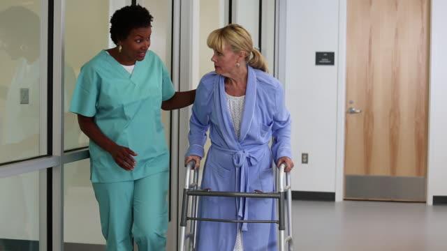 ws nurse worker helping senior woman use walker / richmond, virginia, usa - physiotherapy stock videos & royalty-free footage