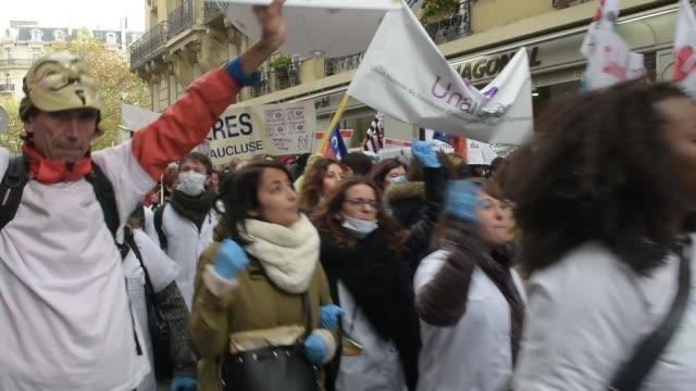 Nurses and care assistants attend a demonstration as part of a nationwide day of protest demanding better working conditions in Paris on November 8...