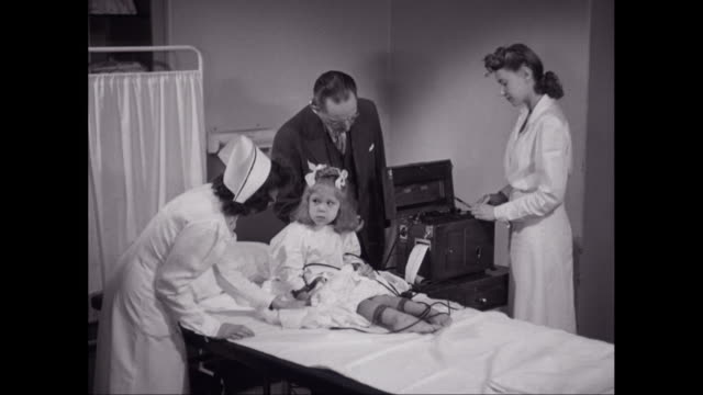 nurses and doctor examining girl's patient's leg / united states - stetoscopio video stock e b–roll
