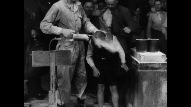 / nurses and doctors delousing the heads of returning german civilians / cu of former ss soldier's arm showing his blood type tattoo health issues in... - 1945 stock-videos und b-roll-filmmaterial