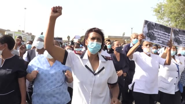 nurses and other health workers demonstrate outside cape town's tygerberg hospital, one of south africa's coronavirus testing and isolation sites,... - contracting stock videos & royalty-free footage