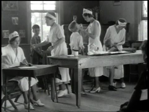 MS nurses attending to children / United States