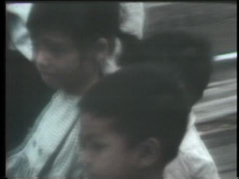 nurses care for orphans waiting to airlifted out of vietnam. - föräldralös bildbanksvideor och videomaterial från bakom kulisserna