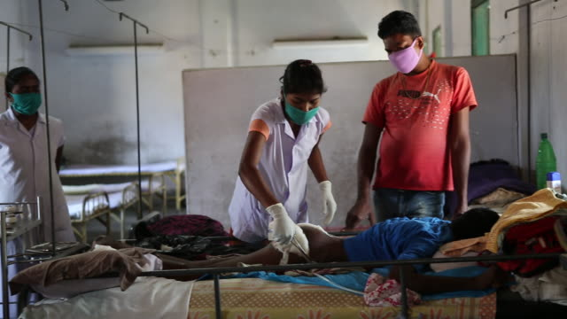 nurses changing the dressing of a patient who has leprosy in a hospital in bagdogra the hospice is located in the northeast of india near the city of... - tuberculosis stock videos & royalty-free footage