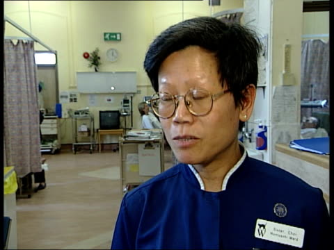 Debate over care of patients ITN ENGLAND London INT Ward sister Choi at female patient's bedside with clipboard Sister Choi interviewed SOT Like to...