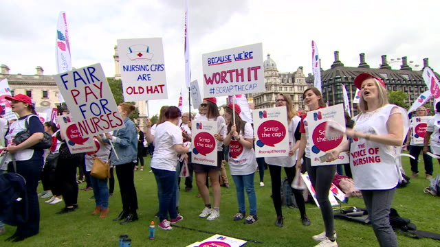Nurses demonstrating outside parliament to end the wage cap on public sector workers