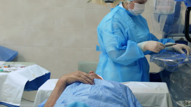 nurses do an eye patch for patient after surgery - bandage stock videos & royalty-free footage