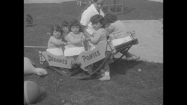 nurses, dr allan dafoe and all 5 dionne quintuplets leaving building; the girls are dressed identically and some carry stuffed toys / group... - ontario canada stock videos & royalty-free footage
