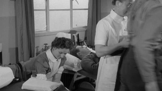 1958 MONTAGE Nurses drawing blood from volunteers / United Kingdom