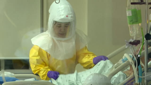 nurses in full ppe personal protective equipment treating coronavirus patients in intensive care unit in seoul south korea - south korea stock videos & royalty-free footage