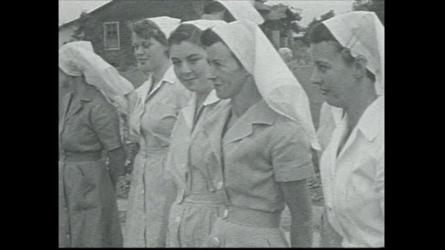 nurses line up out the front of 'margaret reid orthopaedic hospital for crippled children' for the arrival of margot fonteyn black car pulls up /... - little girls giving head stock videos and b-roll footage
