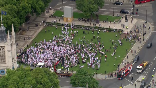 Nurses protest in Parliament Square over public sector pay cap Aerials ENGLAND London Westminster Parliament Square Nurses protesting in Parliament...