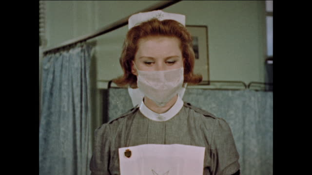 nurses take care of patients in hospital - nhs stock-videos und b-roll-filmmaterial