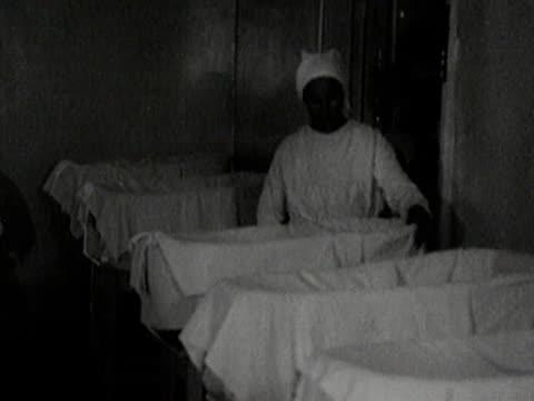 vídeos y material grabado en eventos de stock de nurses taking care of babies and children in soviet orphanage - orfanato