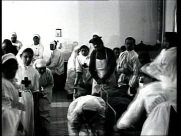 1915 montage b/w nurses taking care of wounded soldiers in war hospital during world war i/ russia - world war one stock videos & royalty-free footage