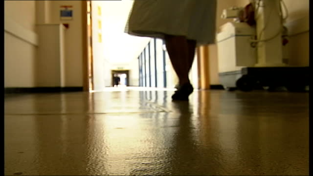 nursing union criticises governments plans to change training; low angle view woman walking along hospital corridor - medical occupation stock videos & royalty-free footage