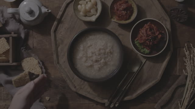 nurungji juk (scorched rice porridge) on the table - table top shot stock videos & royalty-free footage