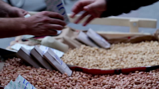 a nut vendor at istanbul turkey - nut food stock videos & royalty-free footage