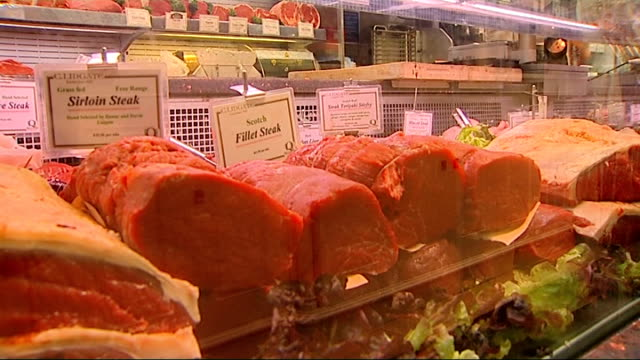 'test tube burger' produced in laboratory england london ext meat displayed in butcher's shop window including chickens veal lamb chops and beef... - kalbfleisch stock-videos und b-roll-filmmaterial