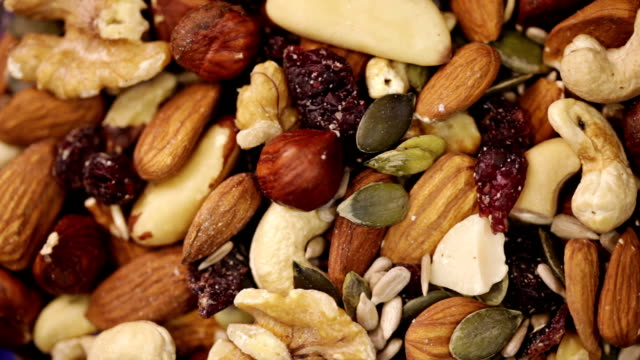 nuts and seeds mix. food background - snack stock videos & royalty-free footage