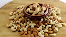 Nuts background. Almond, cashew and brazilian nuts on wooden table