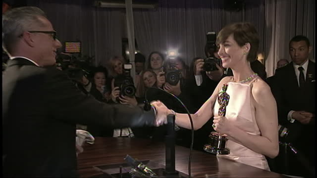 c120 academy awards oscars backstage press room governors ball 2013 academy awards los angeles california anne hathaway at table with trophy at... - produced segment stock videos & royalty-free footage