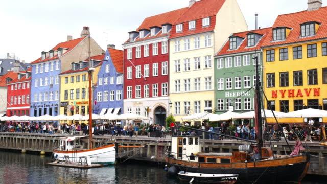 nyhavn, copenhagen, denmark - famous tourist place in scandinavia - copenhagen stock videos & royalty-free footage