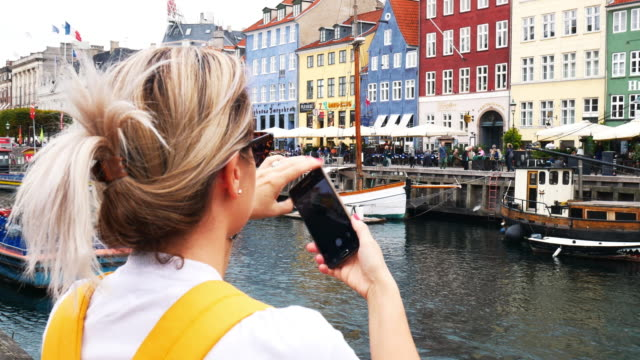 nyhavn, copenhagen, denmark - famous tourist place in scandinavia - denmark stock videos & royalty-free footage