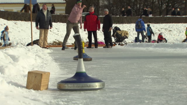 Nymphenburg, man shot curling stick over ice, viewers