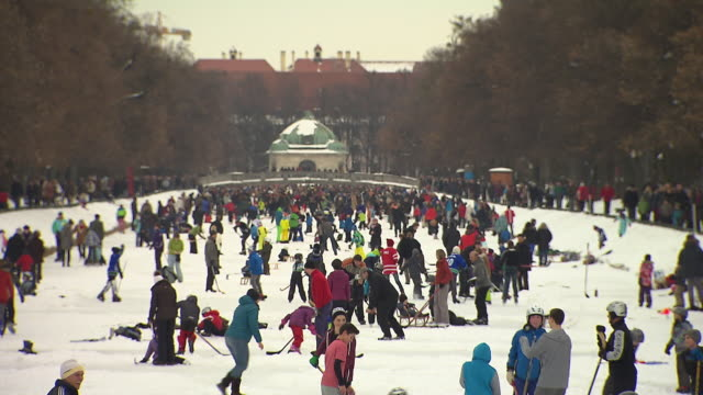 Nymphenburg, people on frozen river, ice hockey, curling, child on sledge