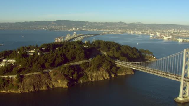 oakland bay bridge spans san francisco bay toward yerba buena island. - san francisco bay stock videos and b-roll footage