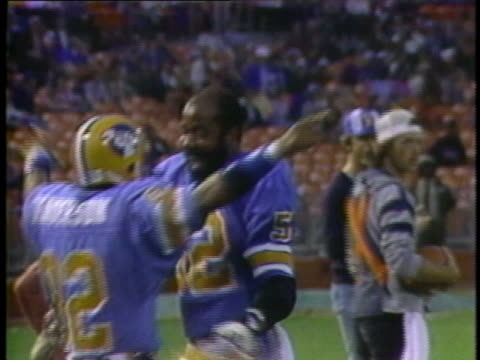 1983 ms oakland invaders football players wyatt henderson and dewey mcclain hugging and dancing on field / usa - high five stock videos & royalty-free footage