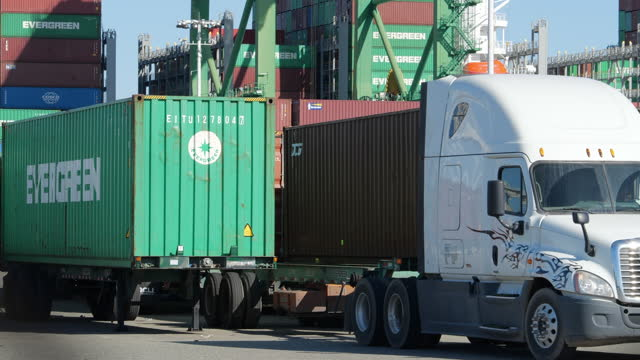 oakland seaport is gearing up to meet the demand, truck is busy with transporting containers. - evergreen stock videos & royalty-free footage
