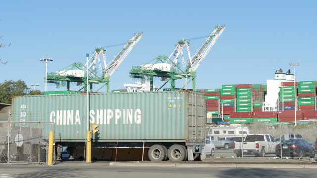 oakland seaport is gearing up to meet the demand, truck is busy with transporting chinese containers. - industry stock videos & royalty-free footage