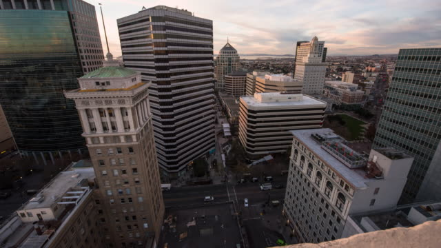 oakland skyline, rooftop day to night - oakland california stock videos & royalty-free footage